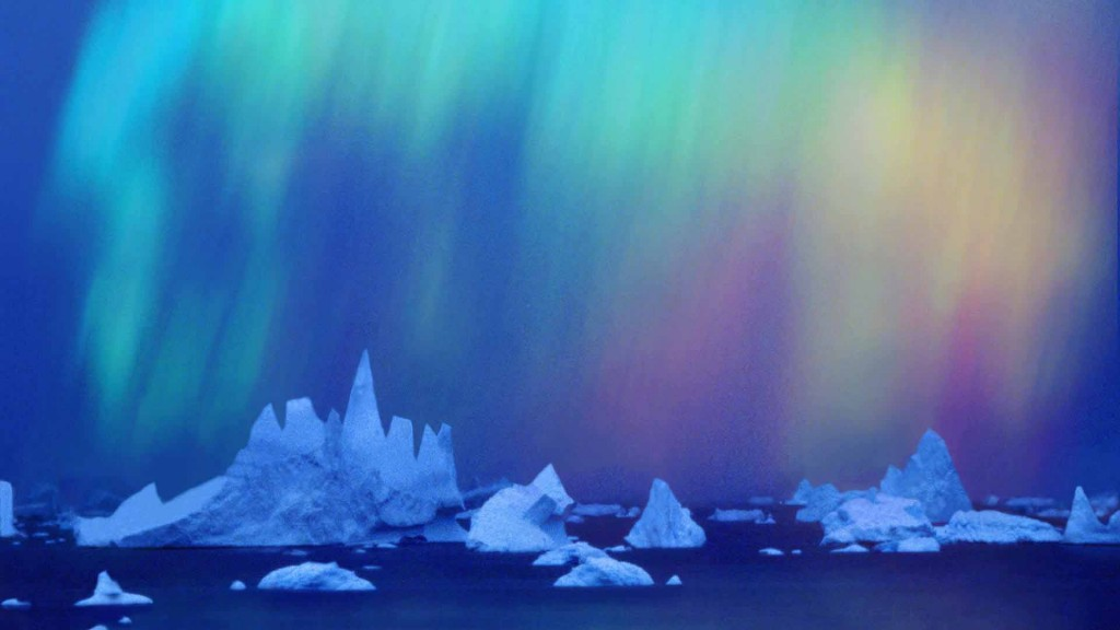 Aurora australis (Southern Light) over icebergs